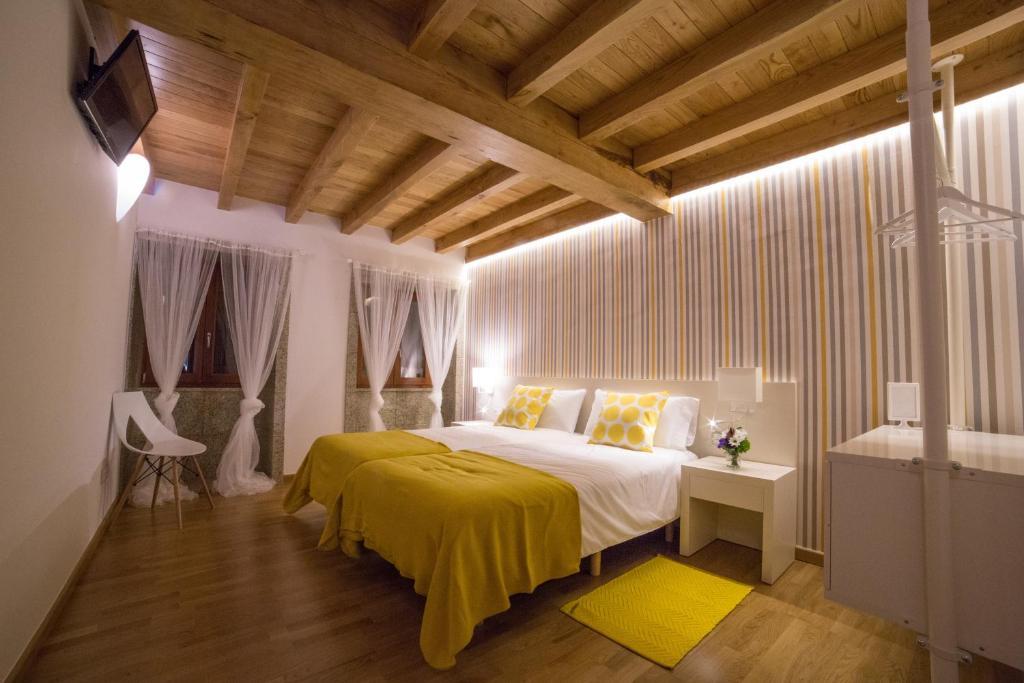 Cama o camas de una habitación en Casa Rural Juancito