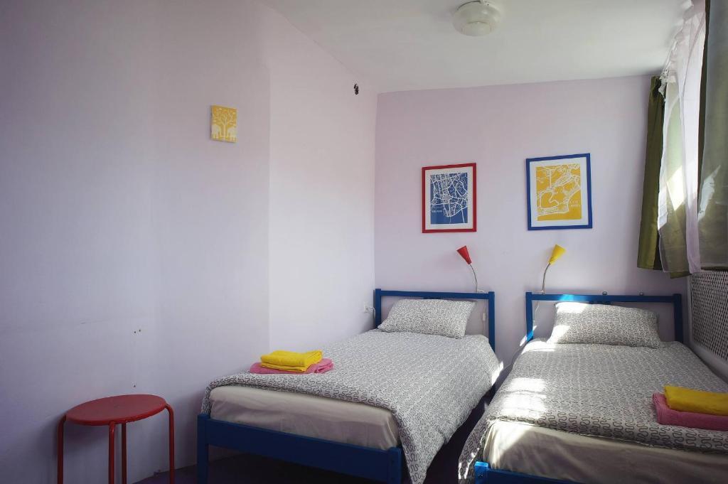 Кровать или кровати в номере J Rooms