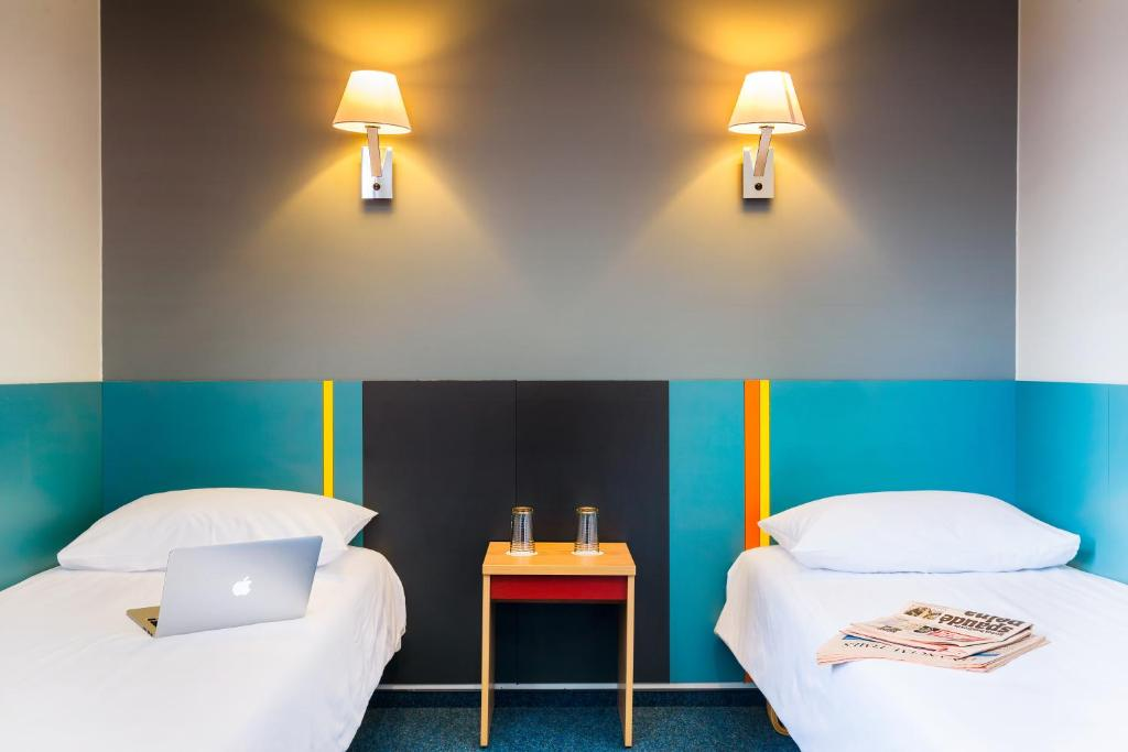 A bed or beds in a room at Ecotel Vilnius