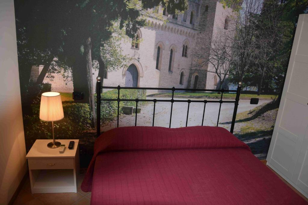 Кровать или кровати в номере Hotel Il boschetto