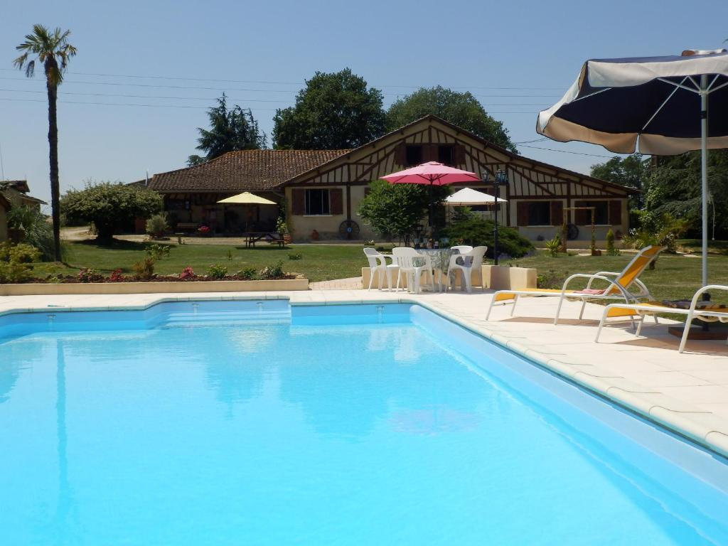 The swimming pool at or near Gîtes Perruchet