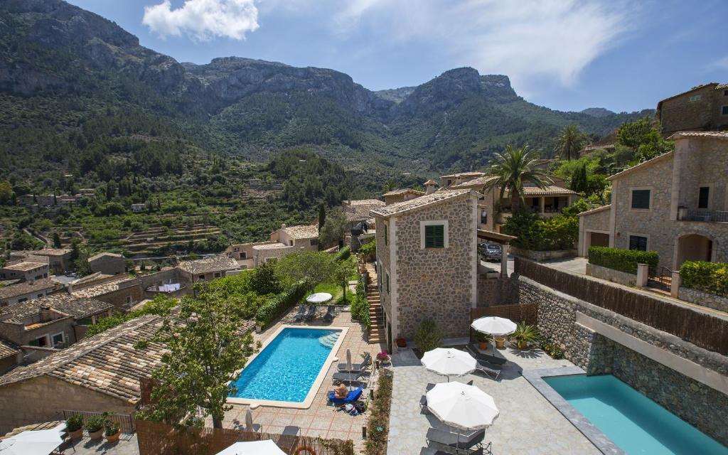 Vista de la piscina de Hotel y Apartamentos DES PUIG o alrededores