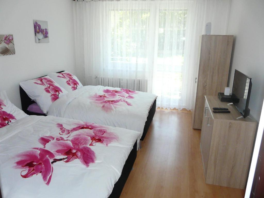 Кровать или кровати в номере Apartment Fialka