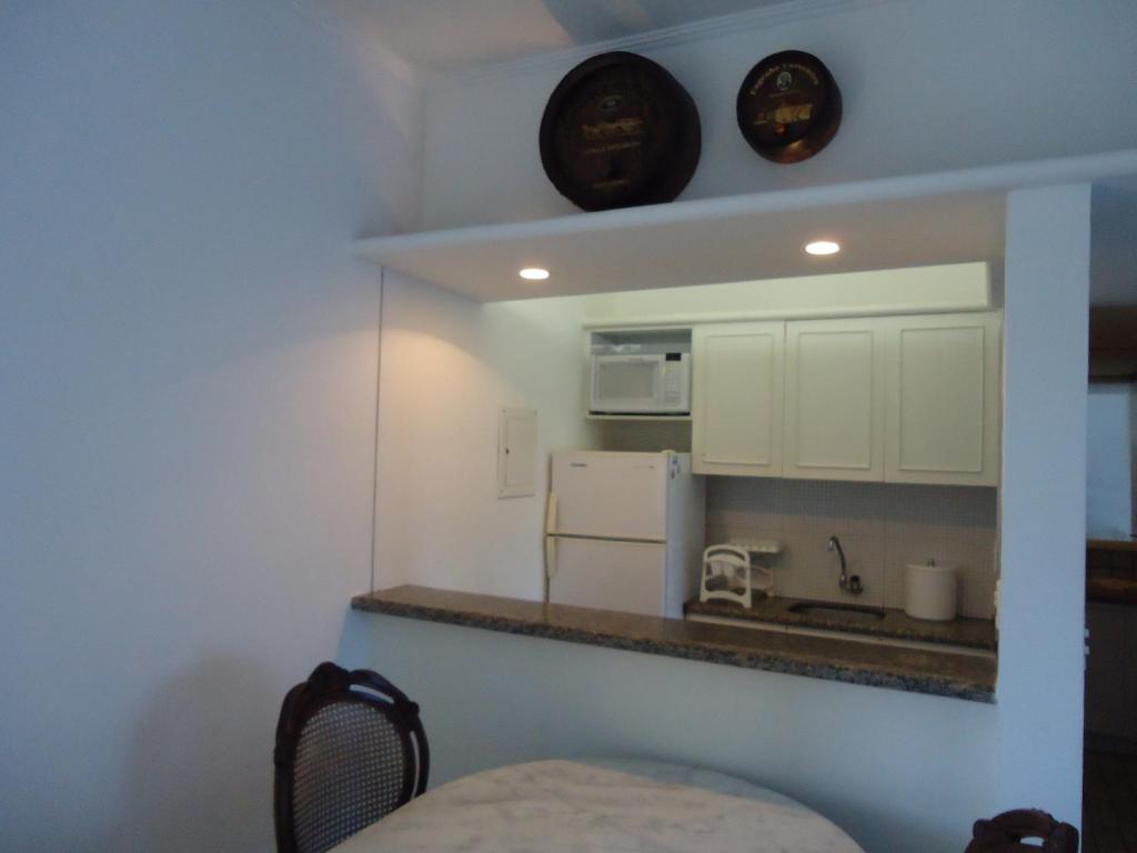 A cozinha ou cozinha compacta de Flat no Hotel Imperial Suites