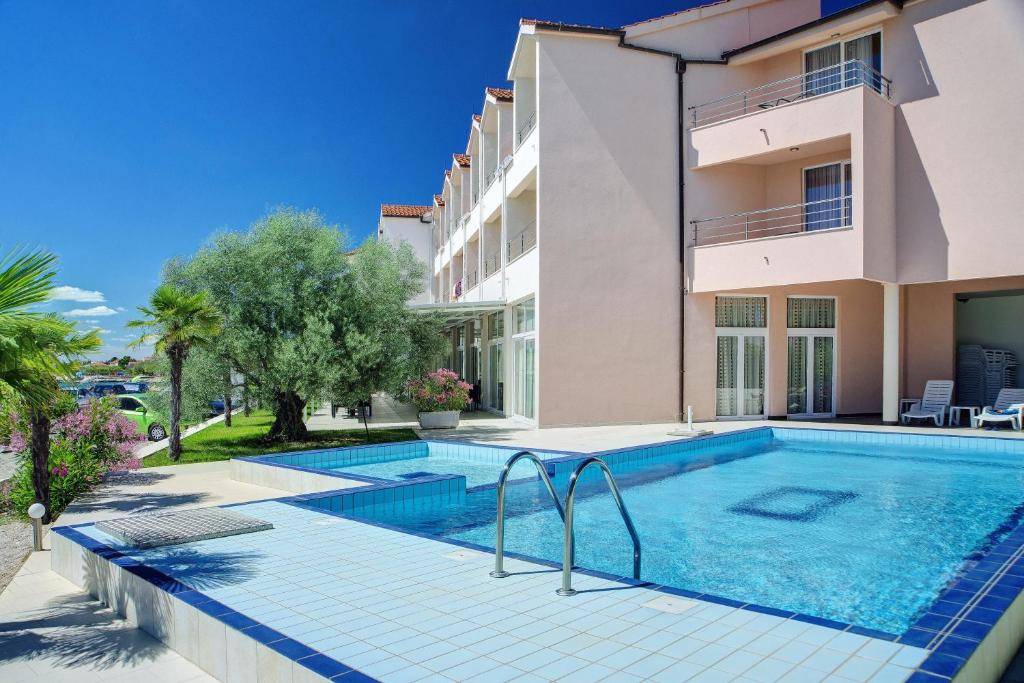 The swimming pool at or near Hotel Duje