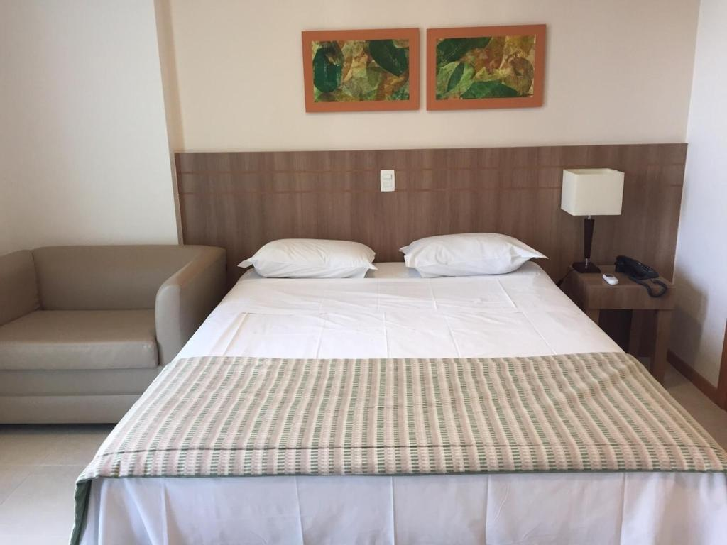 A bed or beds in a room at Flat Brasília - Setor Hoteleiro Norte