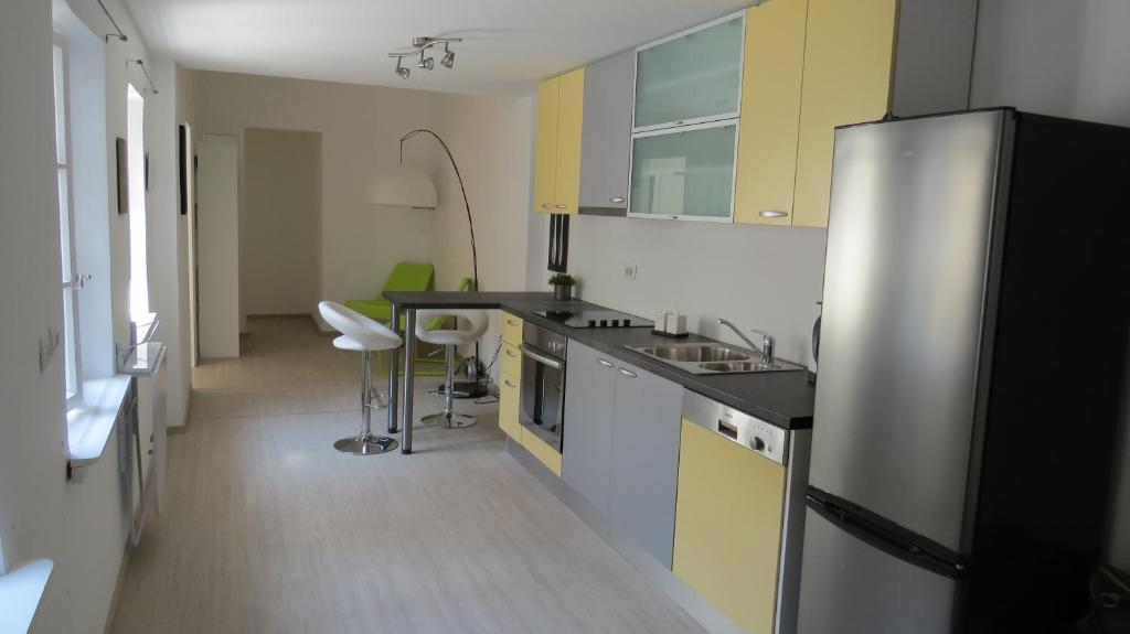 A kitchen or kitchenette at Rooms Old Town