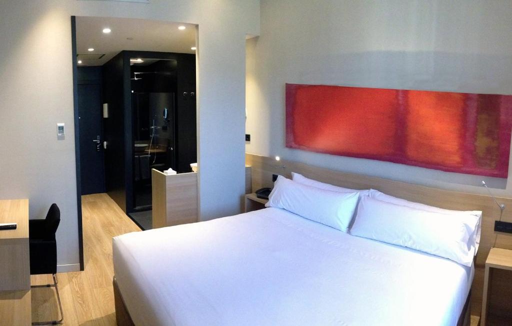 Un ou plusieurs lits dans un hébergement de l'établissement Hotel Àmbit Barcelona