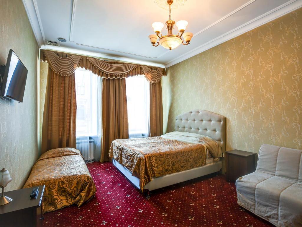 Кровать или кровати в номере Отель Большой 19