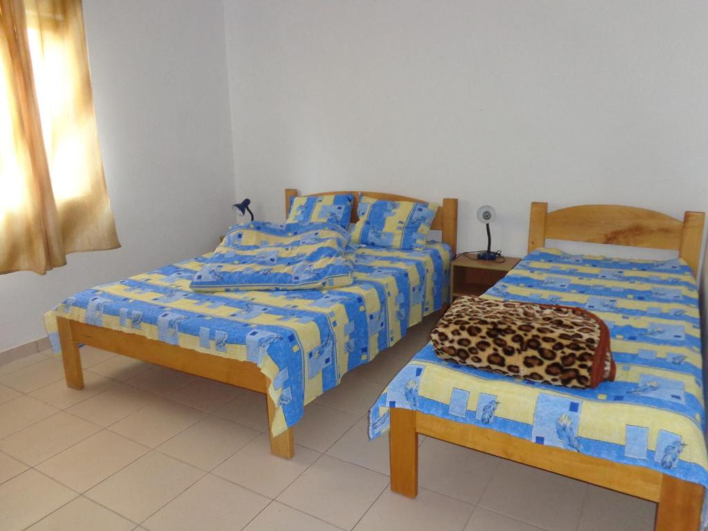 A bed or beds in a room at Vila La Foisor