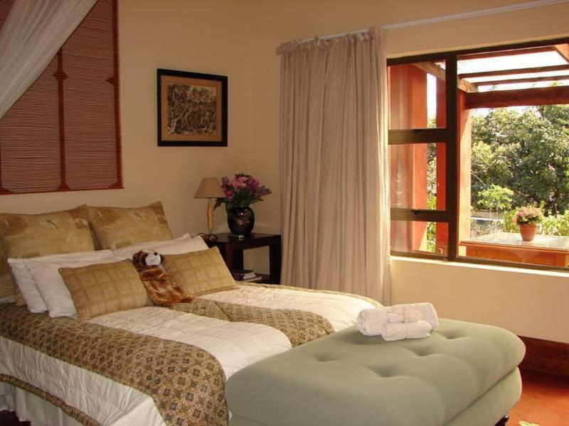 A bed or beds in a room at Ambience Inn