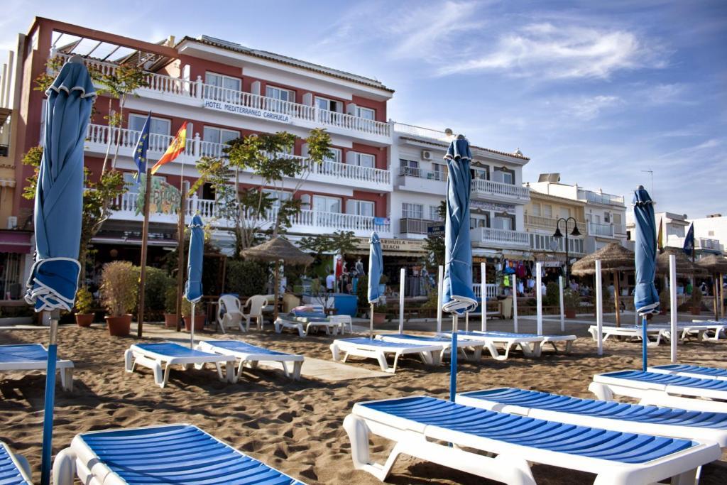 The swimming pool at or near Hotel Mediterraneo Carihuela
