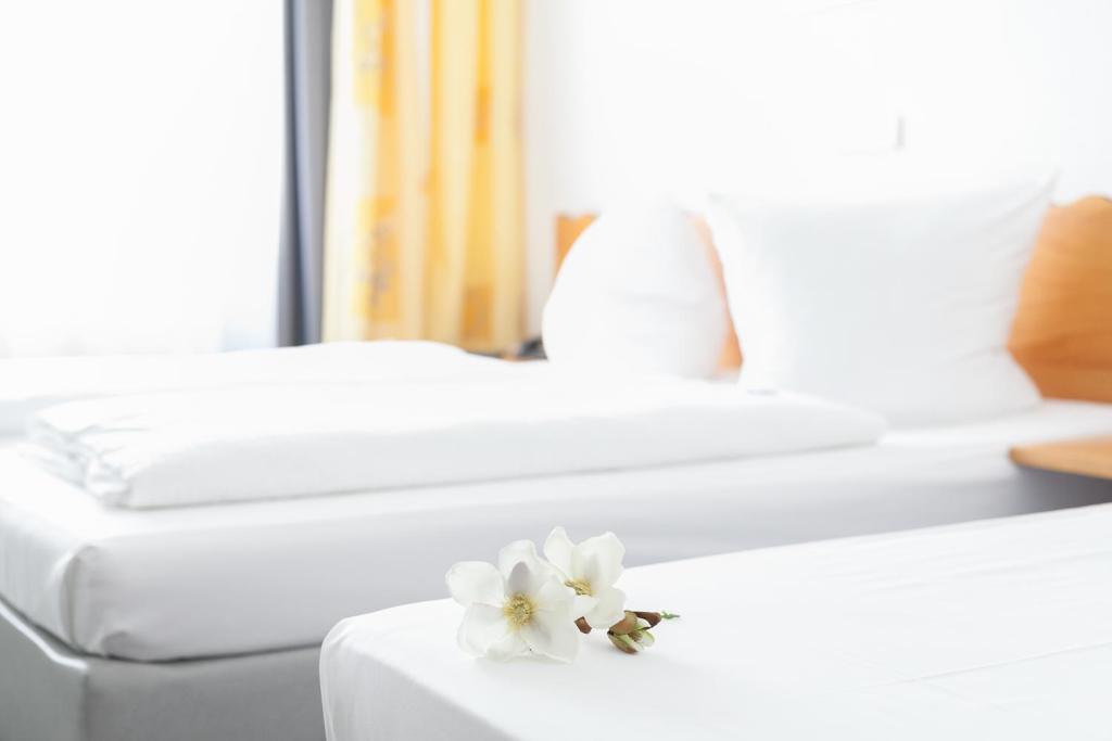 Ein Bett oder Betten in einem Zimmer der Unterkunft Hotel Ambiente