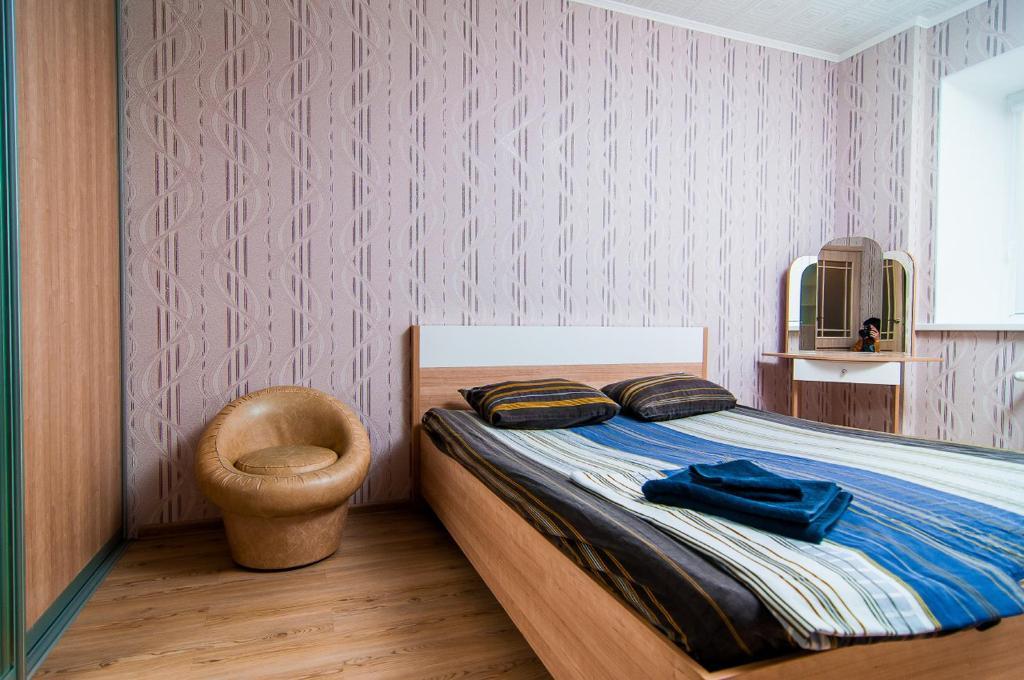 Кровать или кровати в номере April on Kommunisticheskaya 77/2