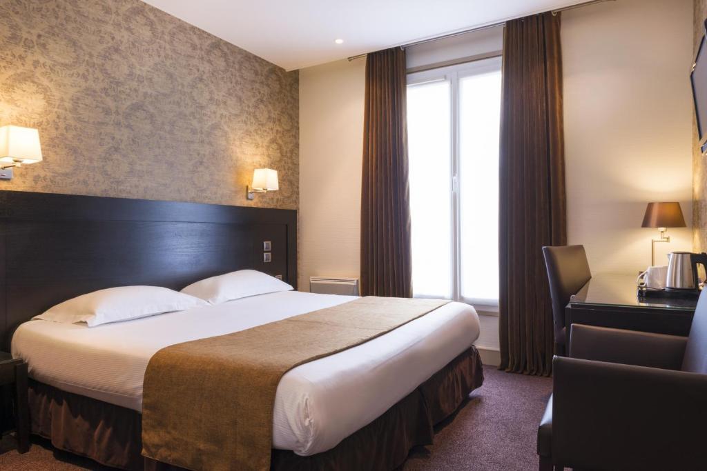 Katil atau katil-katil dalam bilik di Hôtel Volney Opéra