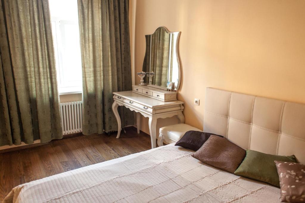 Кровать или кровати в номере Apartment na Reki Moyka 28