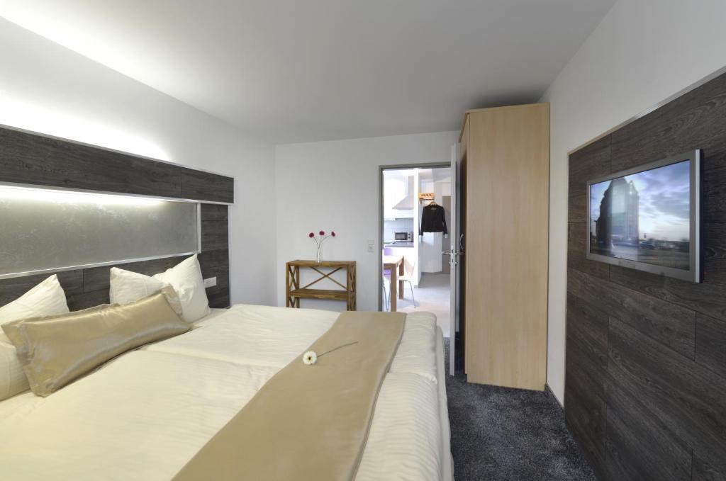 Ein Bett oder Betten in einem Zimmer der Unterkunft Petul Apart Hotel City Premium
