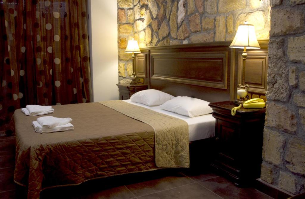 Ένα ή περισσότερα κρεβάτια σε δωμάτιο στο Iris Spa