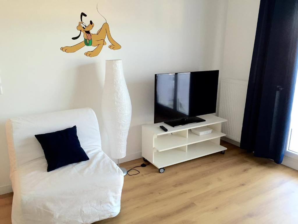 A television and/or entertainment center at Magic Apartments