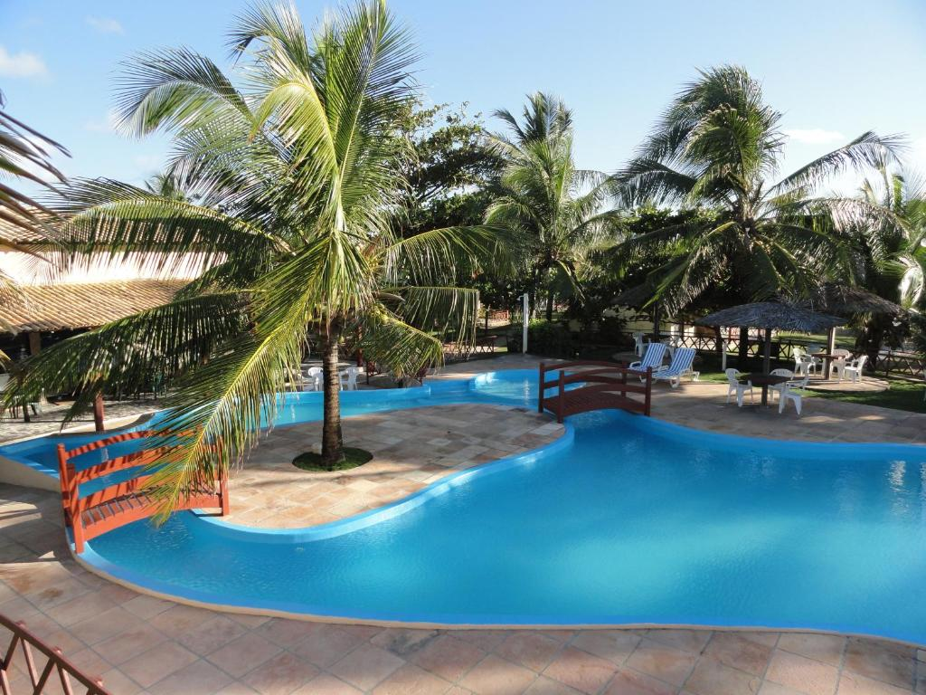 The swimming pool at or near Hotel Coco Beach