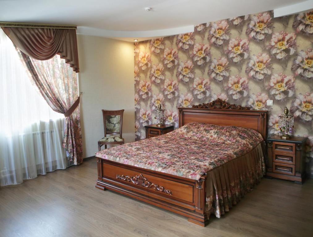 Кровать или кровати в номере Бутик-отель  «Три Богатыря»