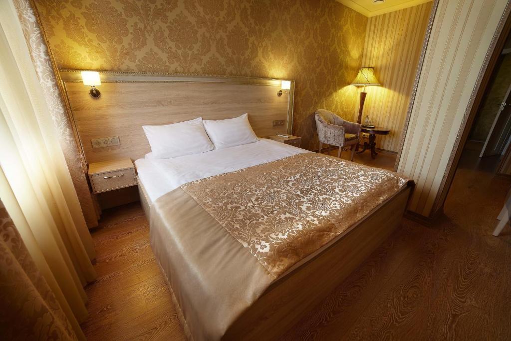 A bed or beds in a room at Отель KA Royal