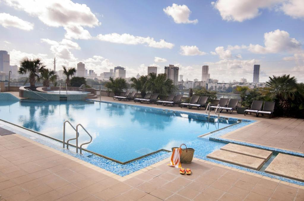 The swimming pool at or near Leonardo City Tower Hotel Tel Aviv