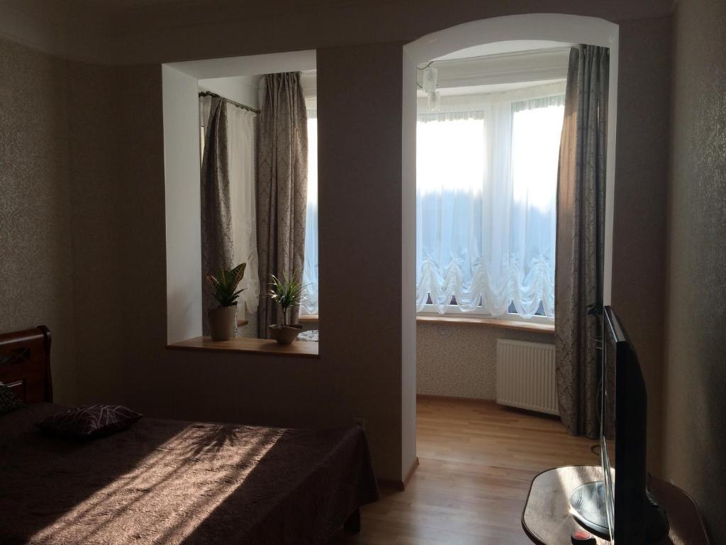 Кровать или кровати в номере Apartment on Krasnaya
