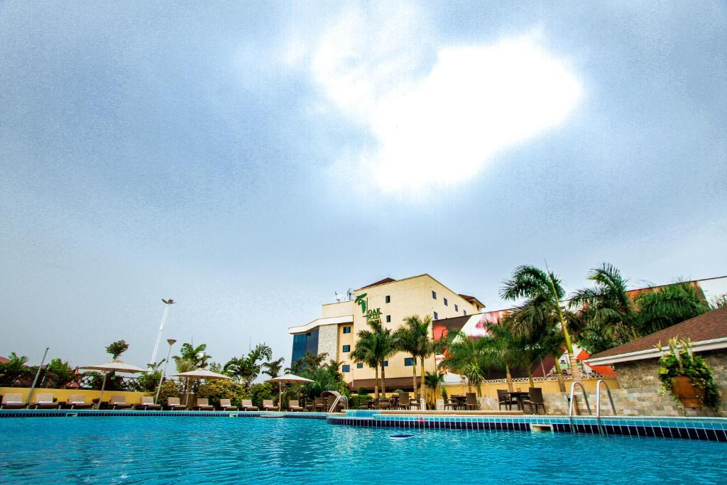 The swimming pool at or near Oak Plaza Hotels East Airport