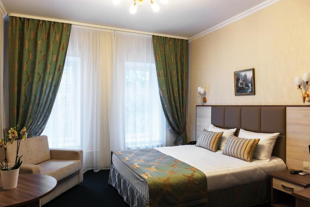 A bed or beds in a room at Seven Hills Brestskaya Hotel