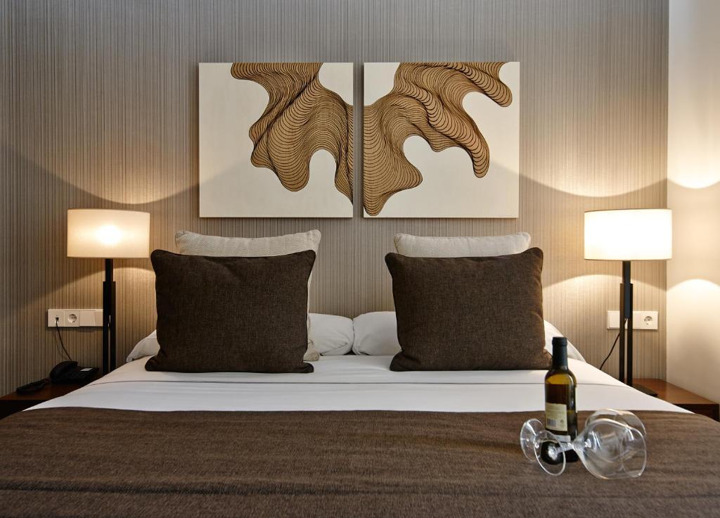 Cama o camas de una habitación en Carris Cardenal Quevedo