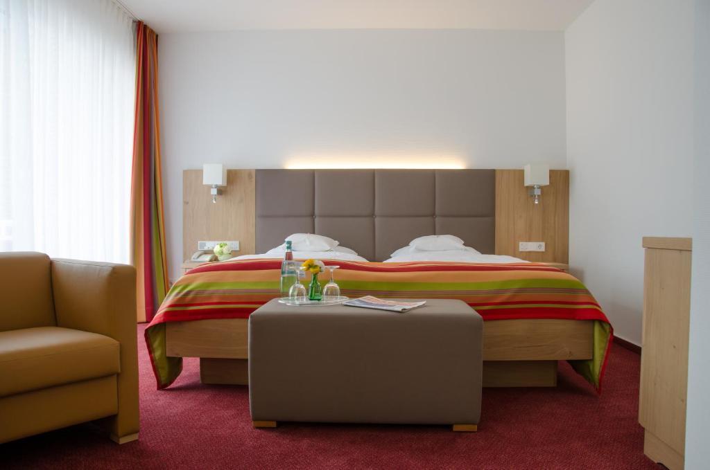 Ein Bett oder Betten in einem Zimmer der Unterkunft Hotel Wieting