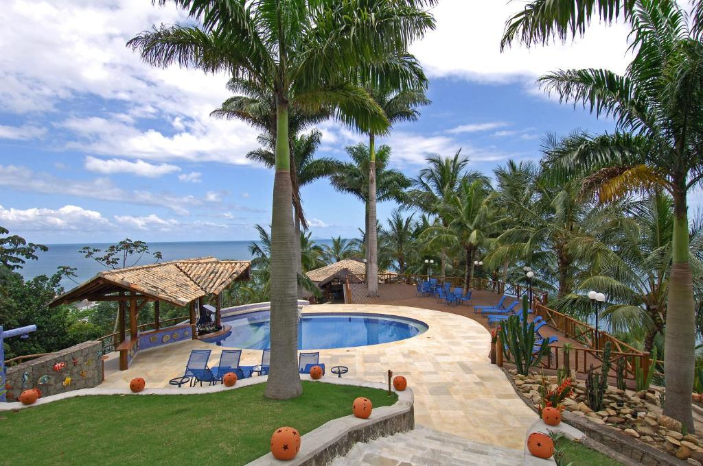 A view of the pool at Pousada Singuitta - Ilhabela or nearby