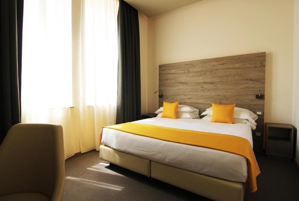 Letto o letti in una camera di Sole Hotel Verona