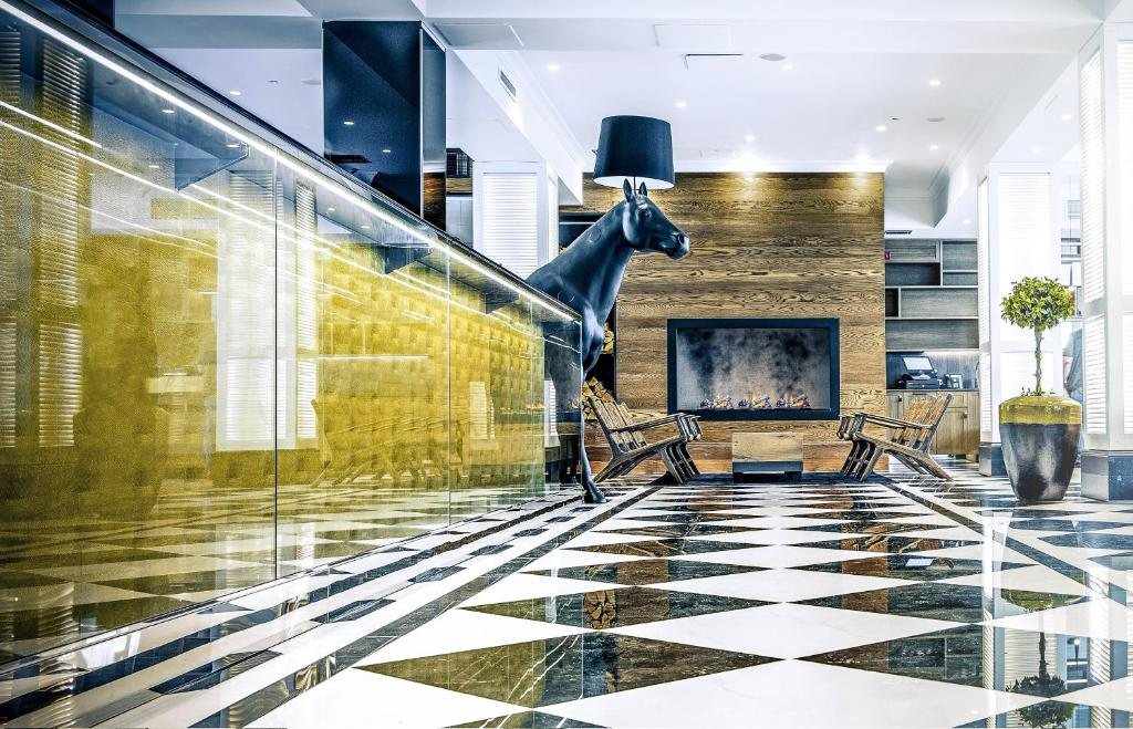 The lobby or reception area at Hotel Lilla Roberts