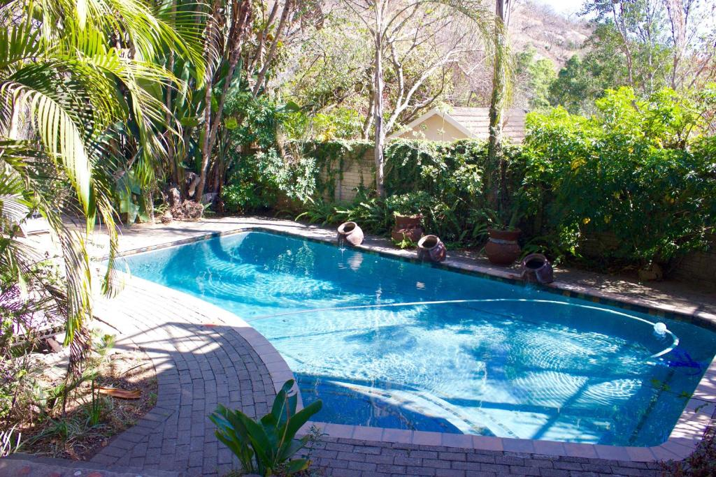 The swimming pool at or near Old Vic Travellers Inn Nelspruit