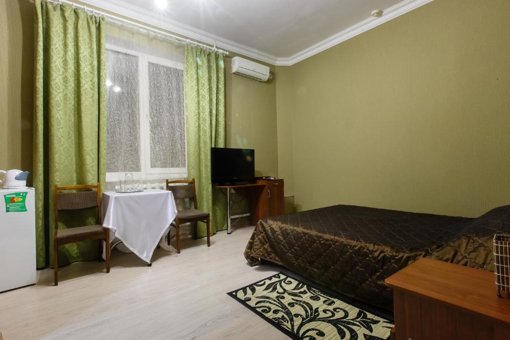 A bed or beds in a room at Zvezdny