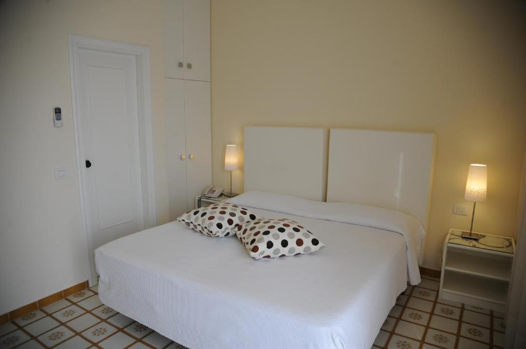 Letto o letti in una camera di Via Capo Rooms