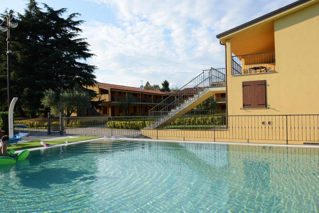 The swimming pool at or near La Perla