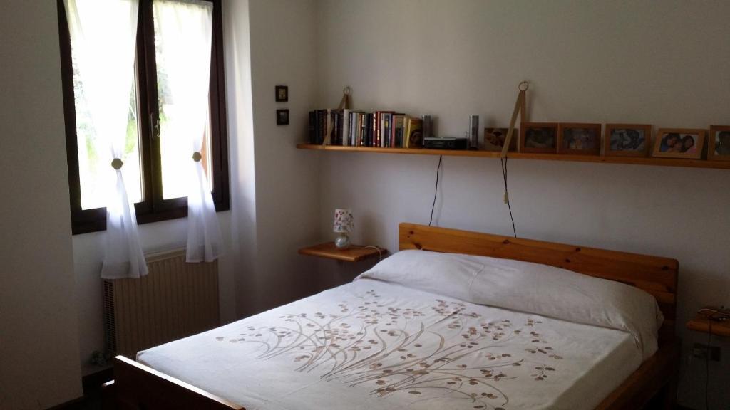 Letto o letti in una camera di Santa Elisabetta Apartment