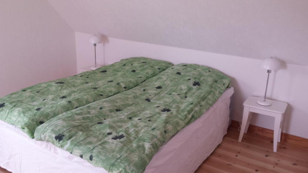Ein Bett oder Betten in einem Zimmer der Unterkunft Huges Bed & Breakfast