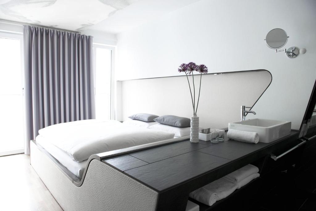 Un ou plusieurs lits dans un hébergement de l'établissement Hotel Q! Berlin