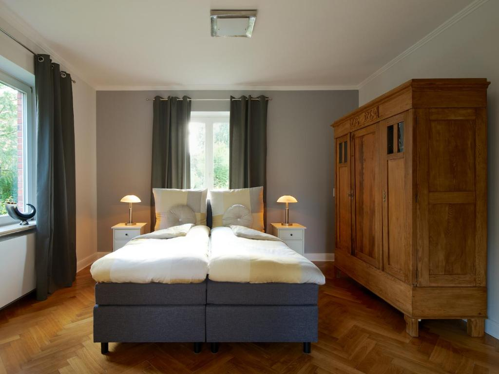 Ein Bett oder Betten in einem Zimmer der Unterkunft Ferienwohnung Glückspilz
