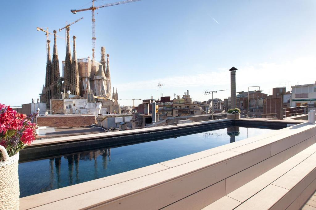The swimming pool at or close to Enjoybcn Gaudi Apartments
