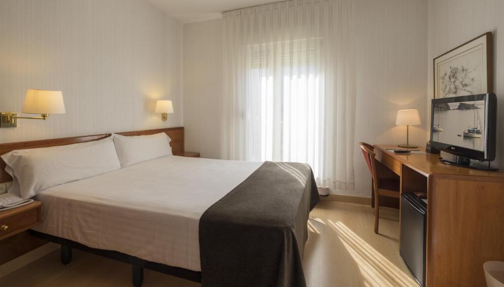 Cama o camas de una habitación en Hotel Ultonia