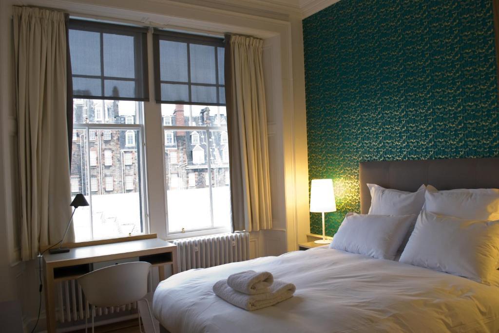 Un ou plusieurs lits dans un hébergement de l'établissement Grasshopper Hotel Glasgow