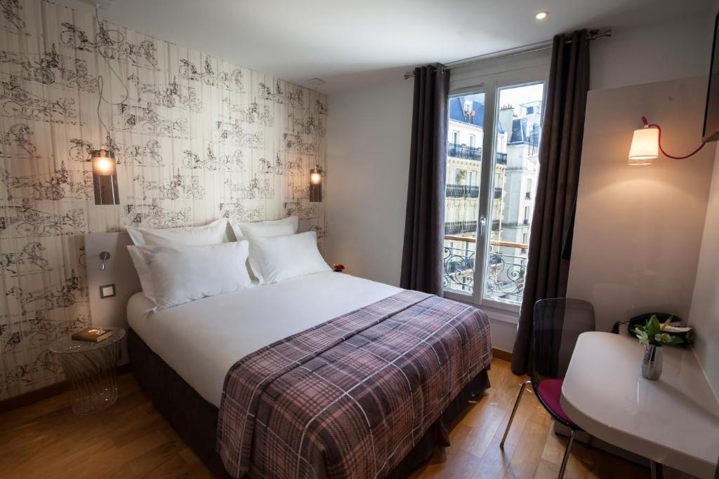 Cama ou camas em um quarto em Le Mireille