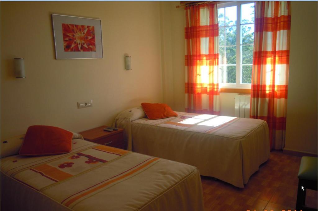 Кровать или кровати в номере O Rancheiro