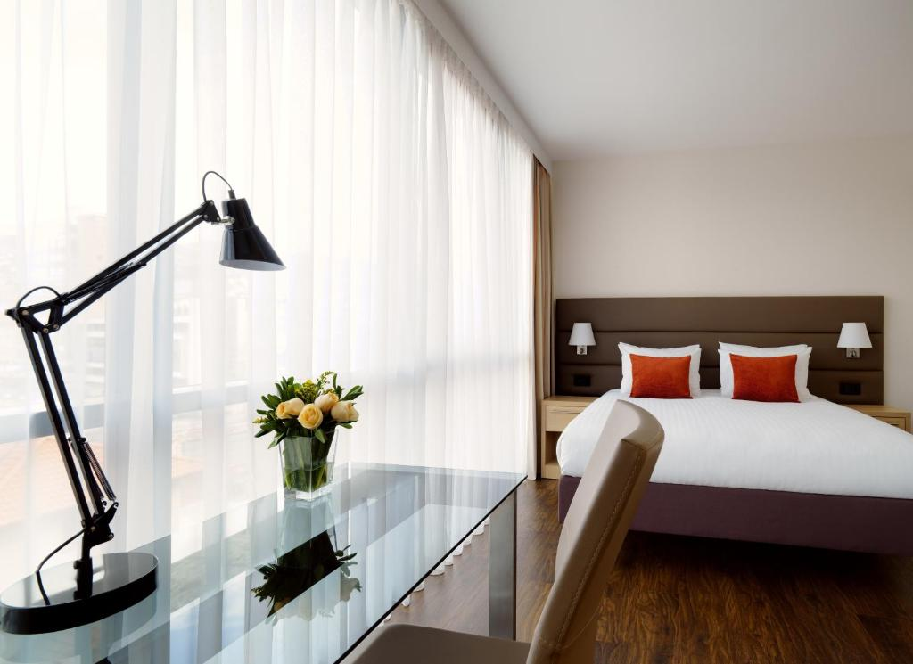 A bed or beds in a room at Residence Inn by Marriott Sarajevo