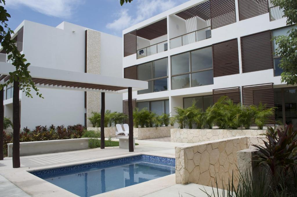 The swimming pool at or near Bahia Principe Vacation Rentals - Quetzal - One-Bedroom Apartments